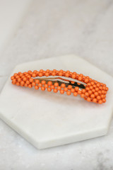Orange - Flat Lay of the Beaded Hair Clip on marble