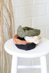 All 4 of the Knotted Headbands on a white stool