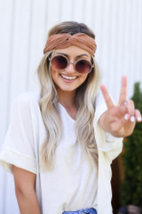 Model wearing the Knotted Headband in Camel