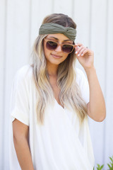 Dress Up model wearing the Knotted Headband in Olive