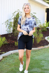 Dress Up model wearing the Biker Shorts with a tie-dye tee and white sneakers