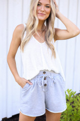 Model wearing the Button Front Shorts in Heather Grey with a white tank