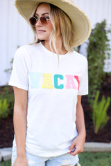 Dress Up model wearing the Vacay Graphic Tee with distressed denim shorts