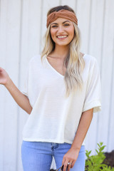 Model wearing the Textured Oversized Top with a knotted headband