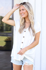 Model wearing the Button Front Babydoll Top in White