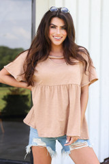 oversized babydoll top with distressed denim shorts