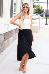 Dress Up model wearing the Wrap Midi Skirt in Black