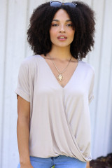 Taupe - Model wearing a Surplice Top with a gold necklace