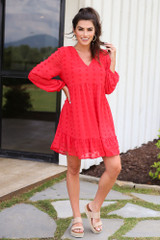 Model wearing he Swiss Dot Babydoll Dress in Red with platform espadrilles