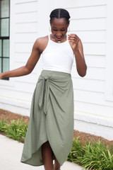 Model wearing the Ribbed Knit Tank in White with an olive wrap midi skirt
