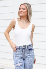 White - Dress Up model wearing the Ribbed Knit Tank Bodysuit with skinny jeans