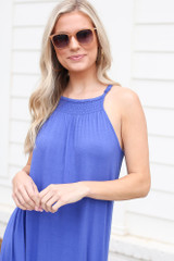 Blue - Dress Up model wearing the Smocked High Neck Maxi Dress with sunglasses