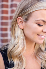 Model wearing the Star Drop Earrings