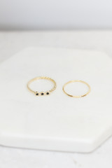 Flat Lay of 2 of the rings in the Dainty Ring Set