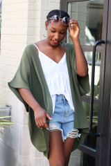 Olive - Model wearing the Lightweight Kimono with denim shorts