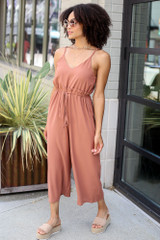 Model wearing the Wide Leg Culotte Jumpsuit in Camel