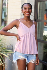 Mauve - Model wearing the Babydoll Tank with denim shorts