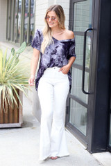 Dress Up model wearing a Tie-Dye Tee with white flare jeans