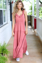 Model wearing the Tiered Maxi Dress in Rust with cute white sneakers