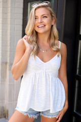 White - Model wearing the Knit Babydoll Tank with distressed denim shorts