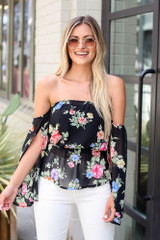 Model wearing the Floral Off-the-Shoulder Blouse in Black