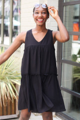 Black - Model wearing the Tiered Swing Dress with sunglasses