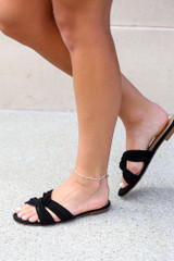 Model wearing the Twist Strap Sandals in Black