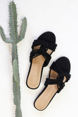Flat lay of the Twist Strap Sandals in Black