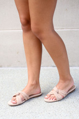Model wearing the Twist Strap Sandals in Taupe