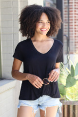 Model wearing the V-Neck Knotted Tee