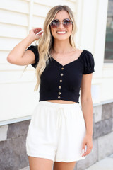 Model wearing the Button Front Crop Top in Black