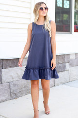Model wearing the Pinafore Ruffle Dress with nude heels