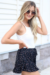 side view floral ruffle shorts with white square neck bodysuit and cute sunglasses