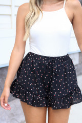 Black - ruffle shorts with floral details