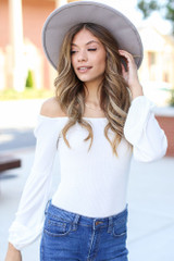 White - basic off the shoulder top styled with flare jeans