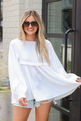 White - textured babydoll top from dress up boutique