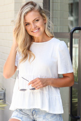 Model wearing the Tie-Back Tiered Top in Ivory