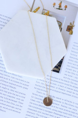 Flat Lay of the Circle Pendant Necklace