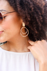 Model wearing the Textured Statement Earrings