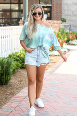 Model wearing the Oversized Tie-Dye Tee with denim shorts and white sneakers