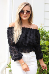 Model wearing the Off The Shoulder Textured Blouse