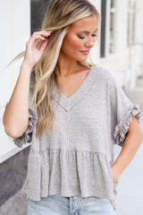 Model wearing the Ribbed Knit Babydoll Top
