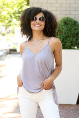 Grey - Model wearing the Oversized Tank with flare jeans
