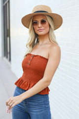 Model wearing the Smocked Top in Rust