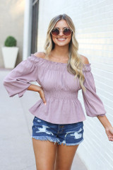 Model wearing the Smocked Off-the-Shoulder Blouse