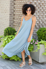 Model wearing the V-Neck Maxi Dress in Blue with platform espadrilles