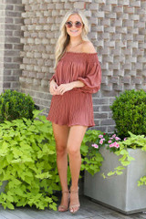Model wearing the Smocked Pleated Romper with nude heels