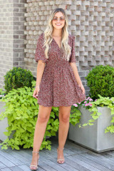 Model wearing the Smocked Floral Dress in Mocha with nude heels
