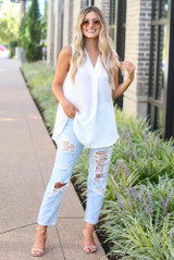Model wearing the V-Neck Dressy Blouse with light wash jeans and nude heels