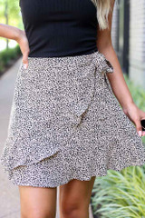 Taupe - Dress Up model wearing the Spotted Wrap Skirt